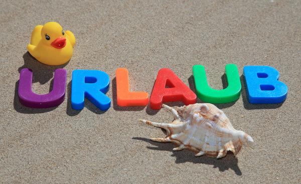 """Schriftzug des Worts """"Urlaub"""""""